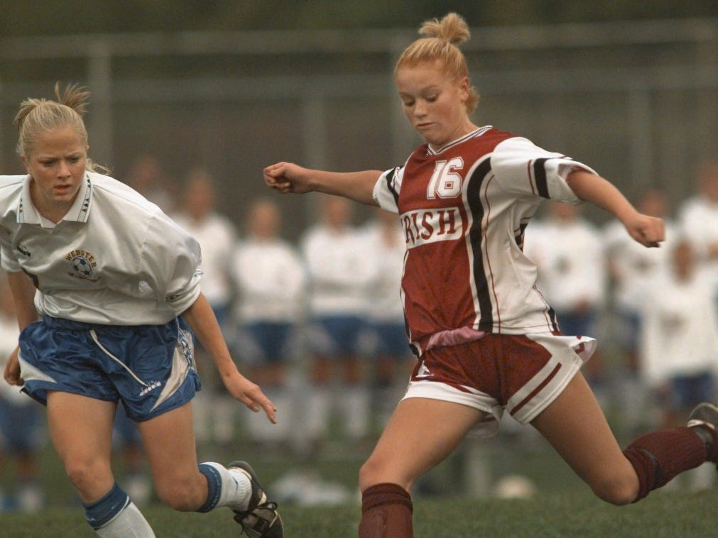 Aquinas' Katie Loomis, right, blasts in her first goal of the night as Webster's Tori Mitchell moves in during the first half of their match Monday, Sept. 27, 1999 at Webster High School.