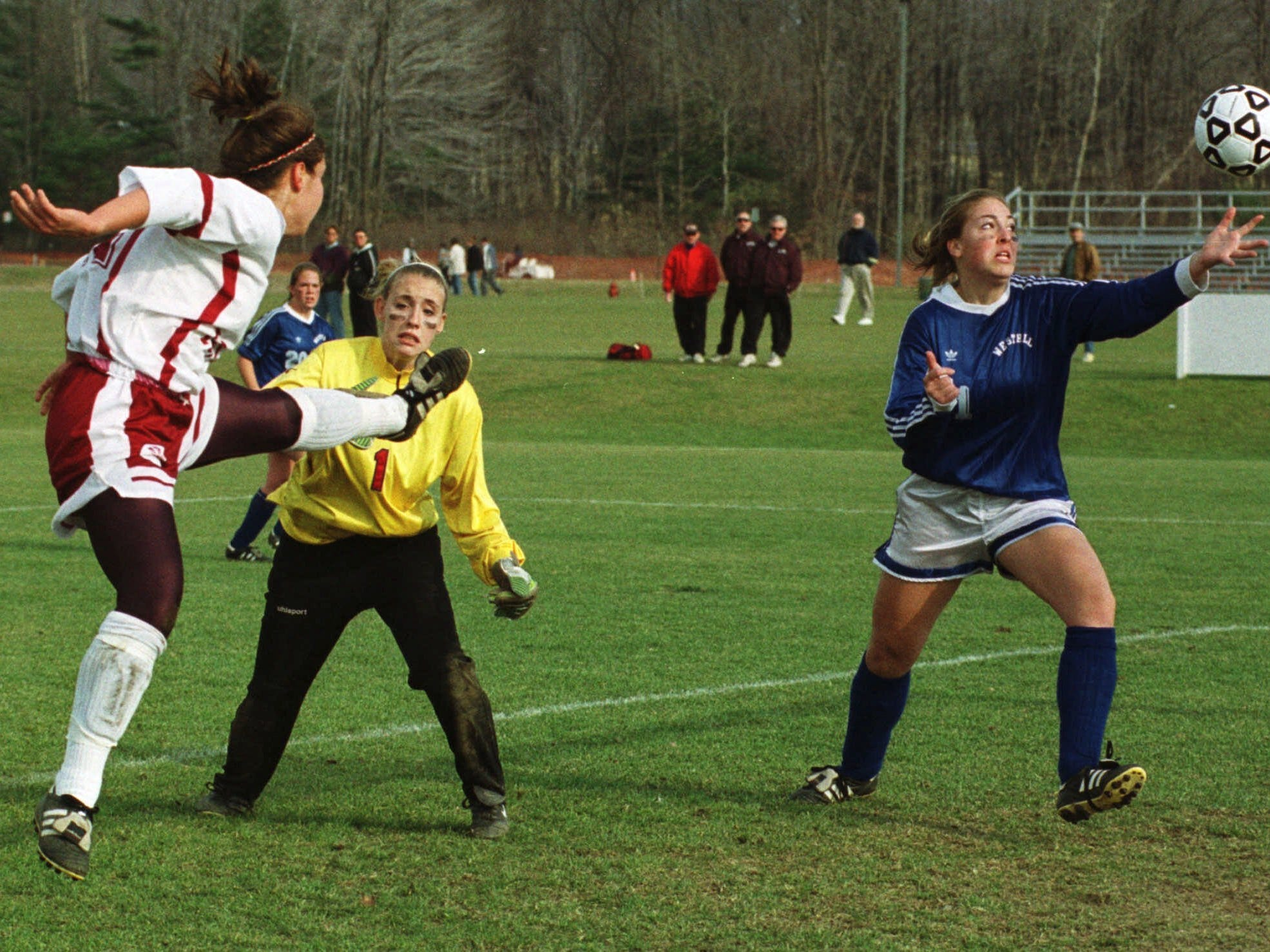 Lindsay Bach, left, shoots and scores as a Westhill defender reaches out to block her goal during the first half of the state Class B finals at Oneonta on Nov. 20, 1999.