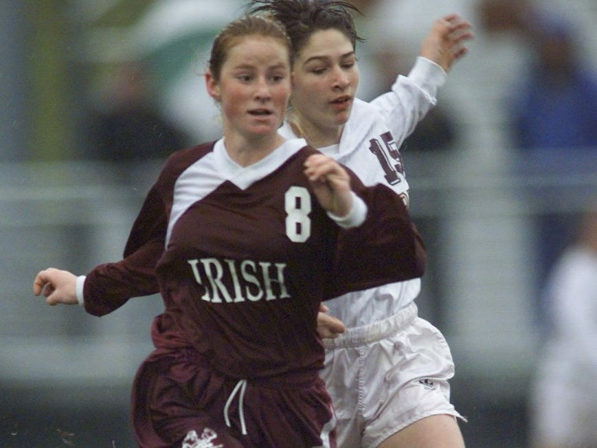 Aquinas's Jenica Schmidt (8) beats Pittsford Mendon's Alycia Evanitsky to the ball during the 1997 sectional finals. Aquinas won 1-0. Schmidt earned All-Greater Rochester honors twice while at Aquinas.