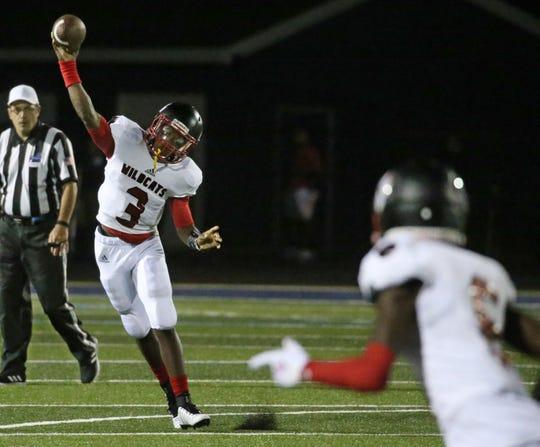 Wilson quarterback Deon Edwards throws a pass downfield to open receiver Khajana Smith.