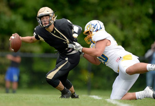 Greece Athena's Nate Bogoniewski, left, is sacked by Irondequoit's Nick Serce on Saturday, Sept. 8, 2018.