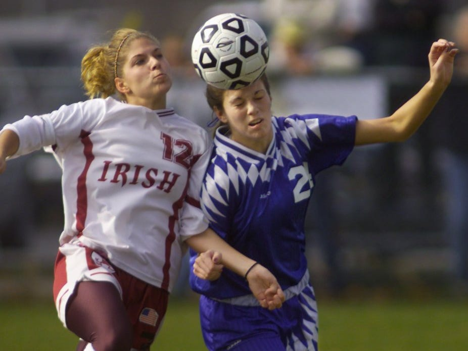 Jacquie Lacek of Aquinas, left, battles for the ball with Oneonta's Jenna Marmet during the second half of their state Class B semifinal game Friday, Nov. 16, 2001 in Churchville. Aquinas won in overtime, 2-1.