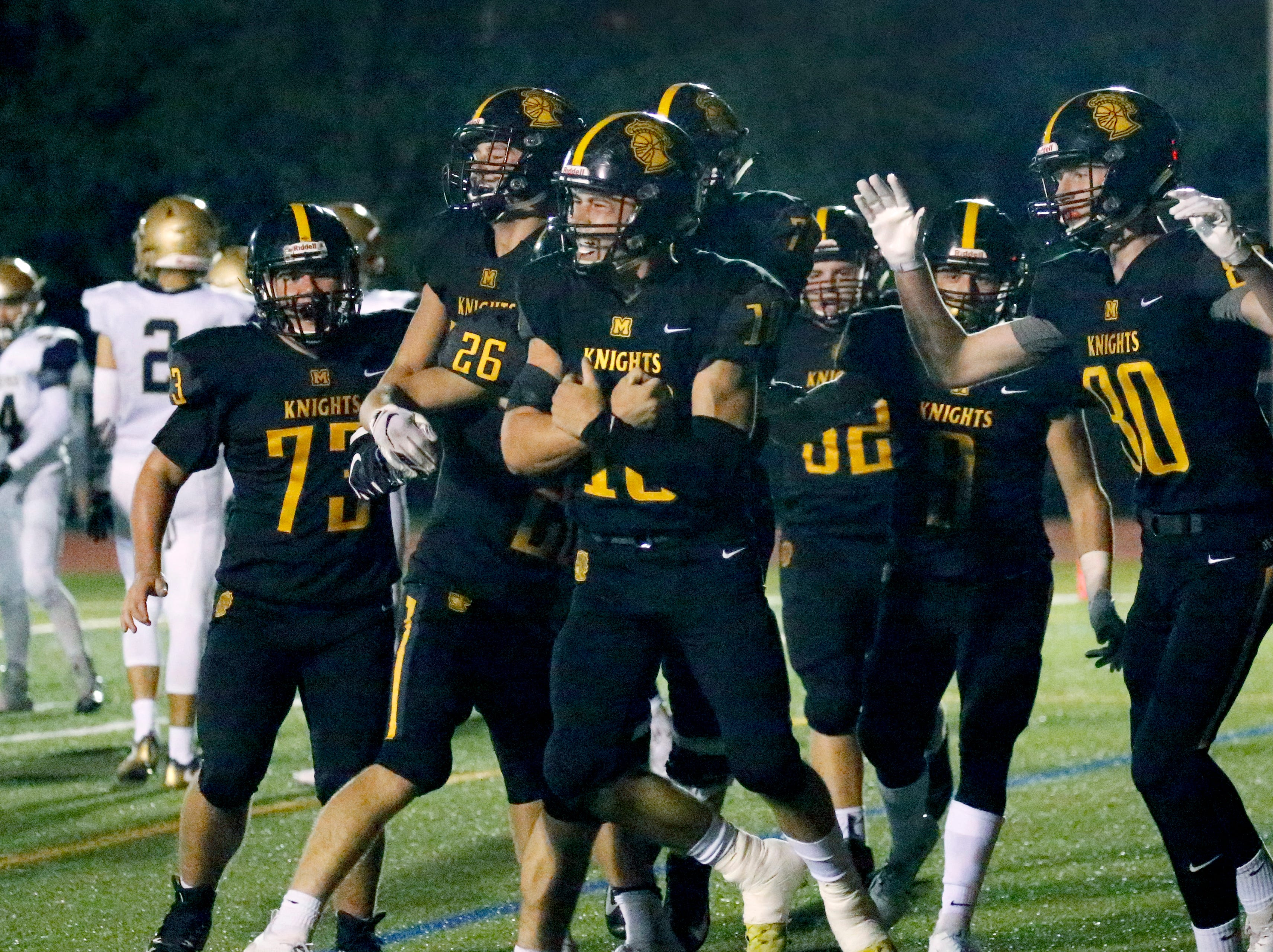 McQuaid's Hunter Walsh celebrates his team's second touchdown that closed the gap to 24-14 in the second quarter at McQuaid Jesuit High School.