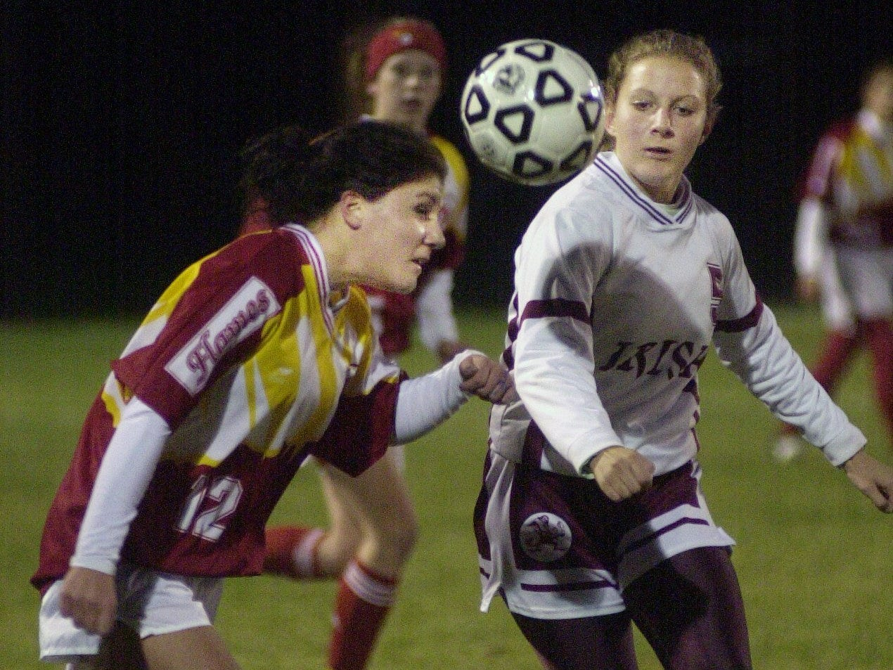 Kelly Roessler of Williamsville East, left, battles with Karen Achtyl of Aquinas during a state playoff game on Nov. 9, 2001.