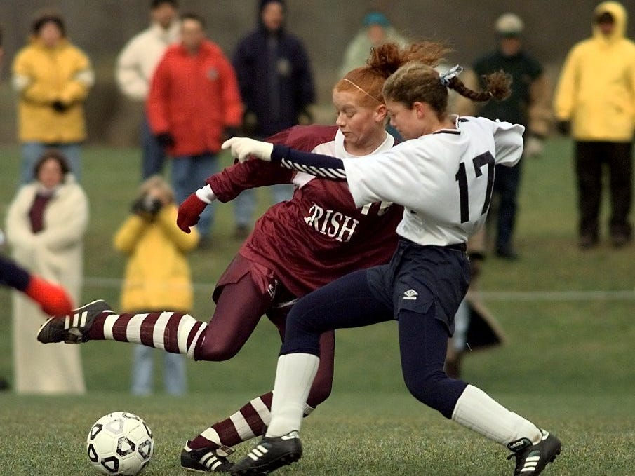 Aquinas's Courtney Pagain, left, colides with North Rockland's Allison Rose, right, while fighting for possetion of the ball in the first half of their game on Nov. 21, 1998.