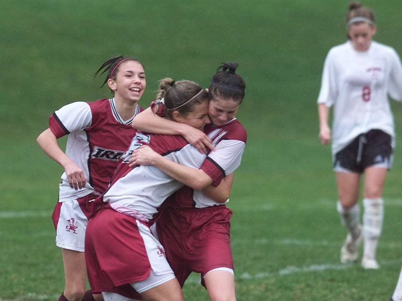 Aquinas' Kaelyn Puidokas (6) is congratulated by teammates , Ashley Grove, left, and Erica Henderson  after her first-half goal against Pittsford Mendon on Oct. 30, 2004.