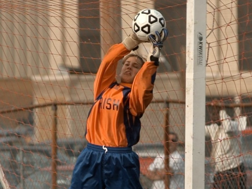 Aquinas goalie Shana Berardi makes a save against Ruch-Henrietta on Sept. 8, 1999.
