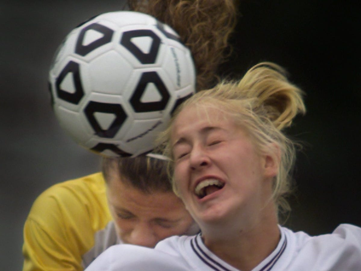 Kristin Lawson (8) of Aquinas and Greece Athena's Katie Frillici knock heads while fighting for a head ball during the first half of their game Wednesday, Sept. 19, 2001 at Aquinas. Frillici had to leave the game for short while after the hard hit. The game finished in a 1-1 tie.
