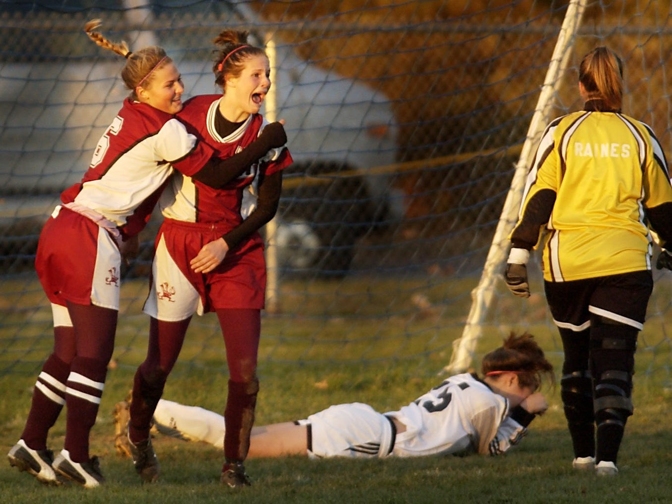Kaelyn Puidokas of Aquinas hugs Erica Henderson after Henderson's goal in the second half of  game on Nov. 6, 2004.