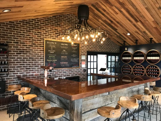 The cozy tasting room at Oak & Apple Cidery in Penfield.