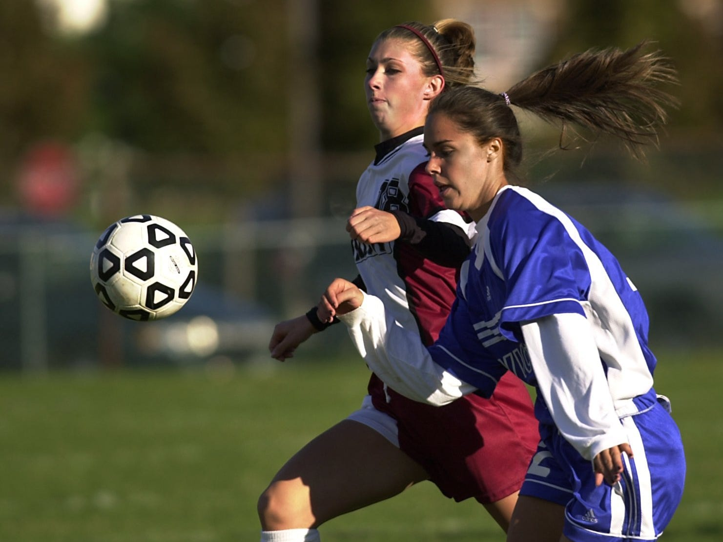 -Aquinas Lindsay Heizyk and Victor's Suzanne Sculli battle for the ball during the first half at Aquinas Institute on Oct. 8, 2002. Reporter is Jeff DiVeronica.