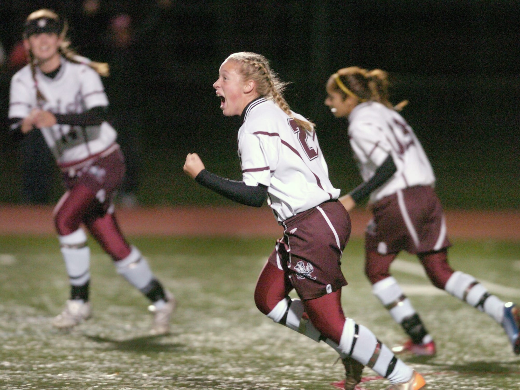Aquinas'  Ashley Hughes,  front, reacts to her first goal in the first half against Greece Athena in the Section V Class AA semifinal soccer game. Hughes also scored on a penalty kick on Oct. 31, 2007