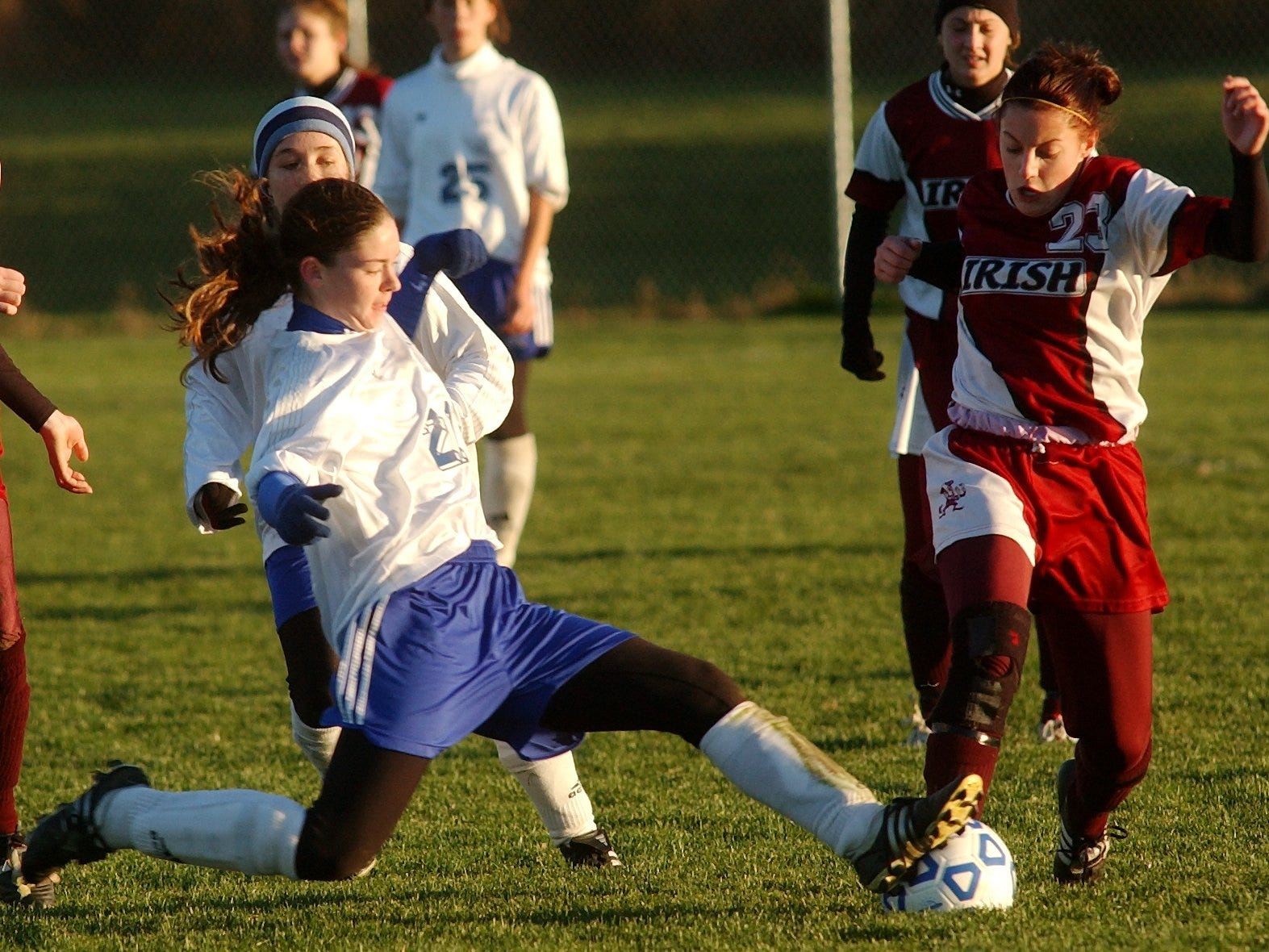 Krista Marcucci of Aquinas is stopped by Grand Island's Sara Hilliard in a state playoff game on Nov. 13, 2004 at Albion.