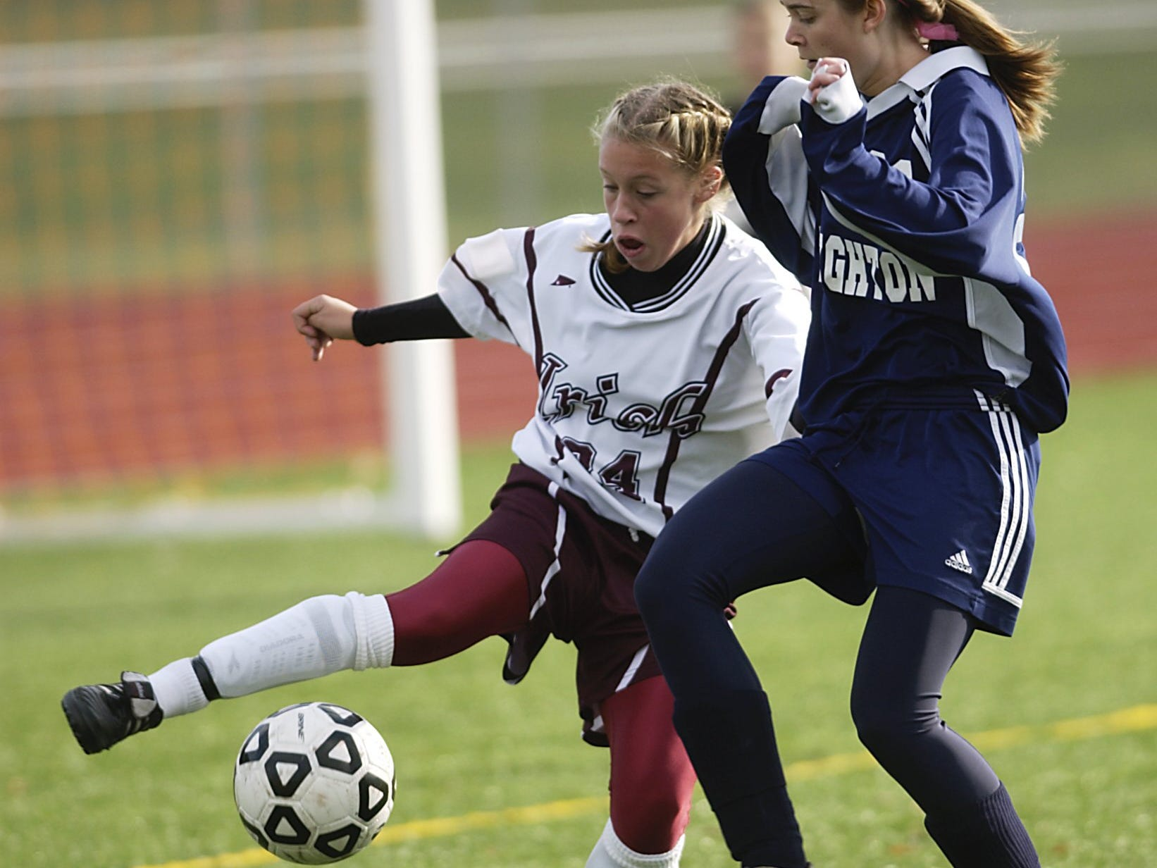 Ashley Hughes of Aquinas keeps the ball away from Brighton's Grace Conley during the second half of Aquinas' 4-0 victory on Oct. 29, 2005.