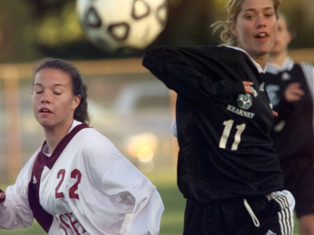 Aquinas defender Danielle Meagher battles Bishop  Kearney Shannon Harrison for the ball during a game on Oct. 14, 1997.