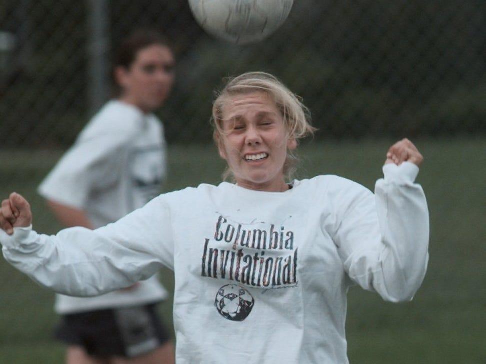 Aquinas senior midfielder Dana Jarzyniecki during a 1998 practice.