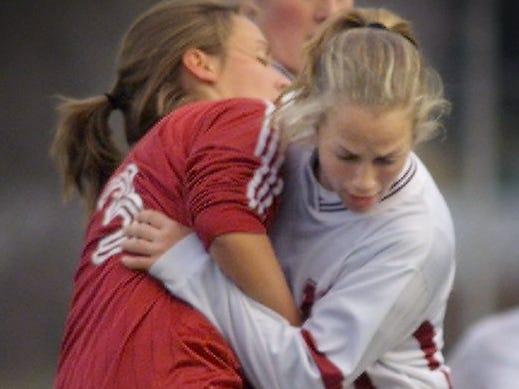 Aquinas' Lauren Popovich, right, tries to fight through Jaclyn Brisson of Burnt Hills to get to the ball during the first half of their Class B state semifinal game on  Nov. 17, 2000 at Webster High School.