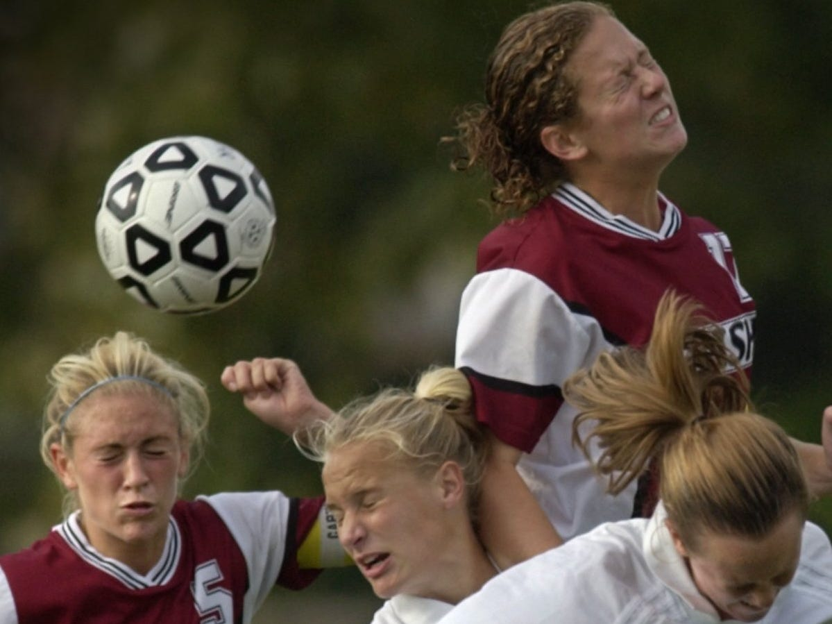 Aquinas's Kelsey Turley (17), top right, and teammate Rachelle Cariello (5), left, battle with Mercy's Gretchen Miller center, and her teammate Kathleen Martin for a head ball during their game Tuesday, Sept. 14, 2004 at Mercy High School in Brighton. Aquinas won the game 2-1.