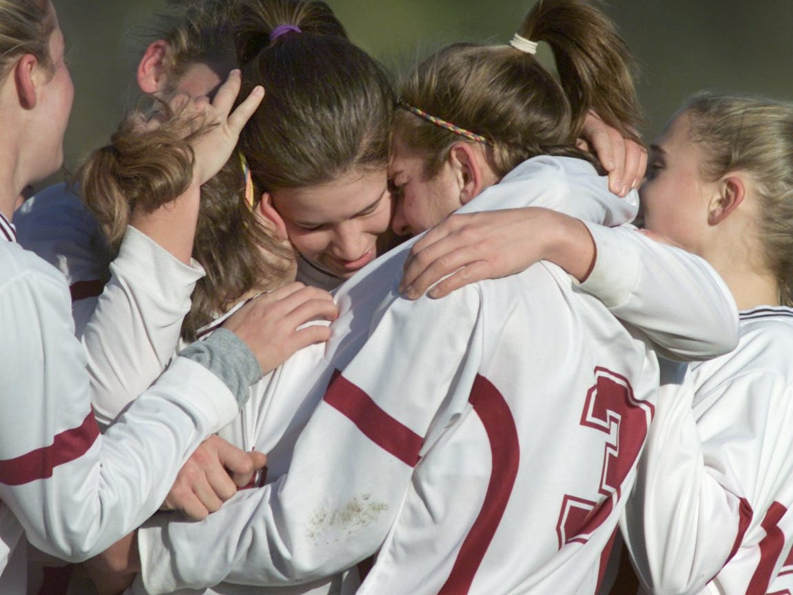 Aquinas players celebrate Jacquie Lacek's second-half goal during their win over Burnt Hills in the girls Class B State semifinals on Friday, Nov. 17, 2000 at Webster High School. Pictured are Lauren Mort, center facing camera, Sarah Elnicky, #3, right, and Lacek, left.
