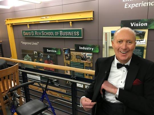 David Reh smiles inside the David Reh School of Business