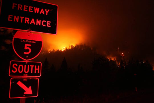The Delta Fire continued to burn on the ridge line east of I-5 just south of the Gibson Road exit on Friday evening, Sept. 7, 2018. (Hung T. Vu/ Special to the Record Searchlight)