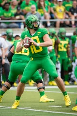 Oregon Justin Herbert throws a pass during the first half against Portland State.