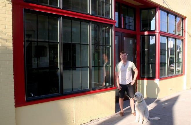 Owner Bob Bochsler stands outside of Momente.