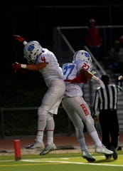 North Salinas's Matt Morales, left, and Angel Sandoval celebrate after Morales' touchdown during football at Everett Alvarez High School in Salinas on Friday September 7, 2018.  (Photo By David Royal)