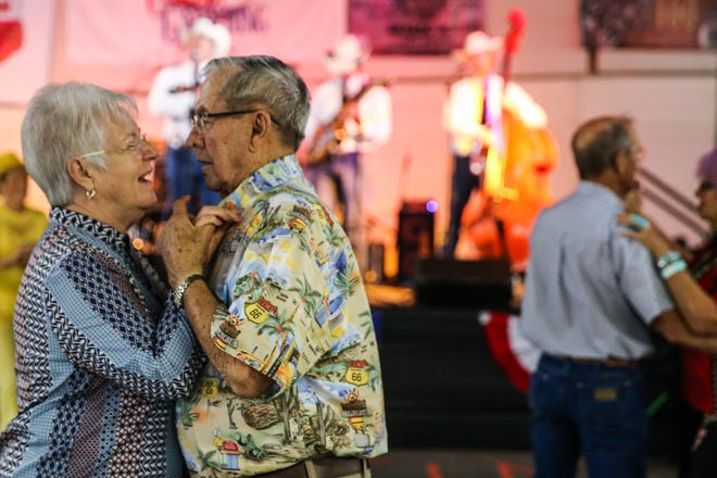 Music lovers dance during the 6th annual Cowboy Gathering Saturday, Sept. 8, 2018, at Wells Fargo Pavilion.