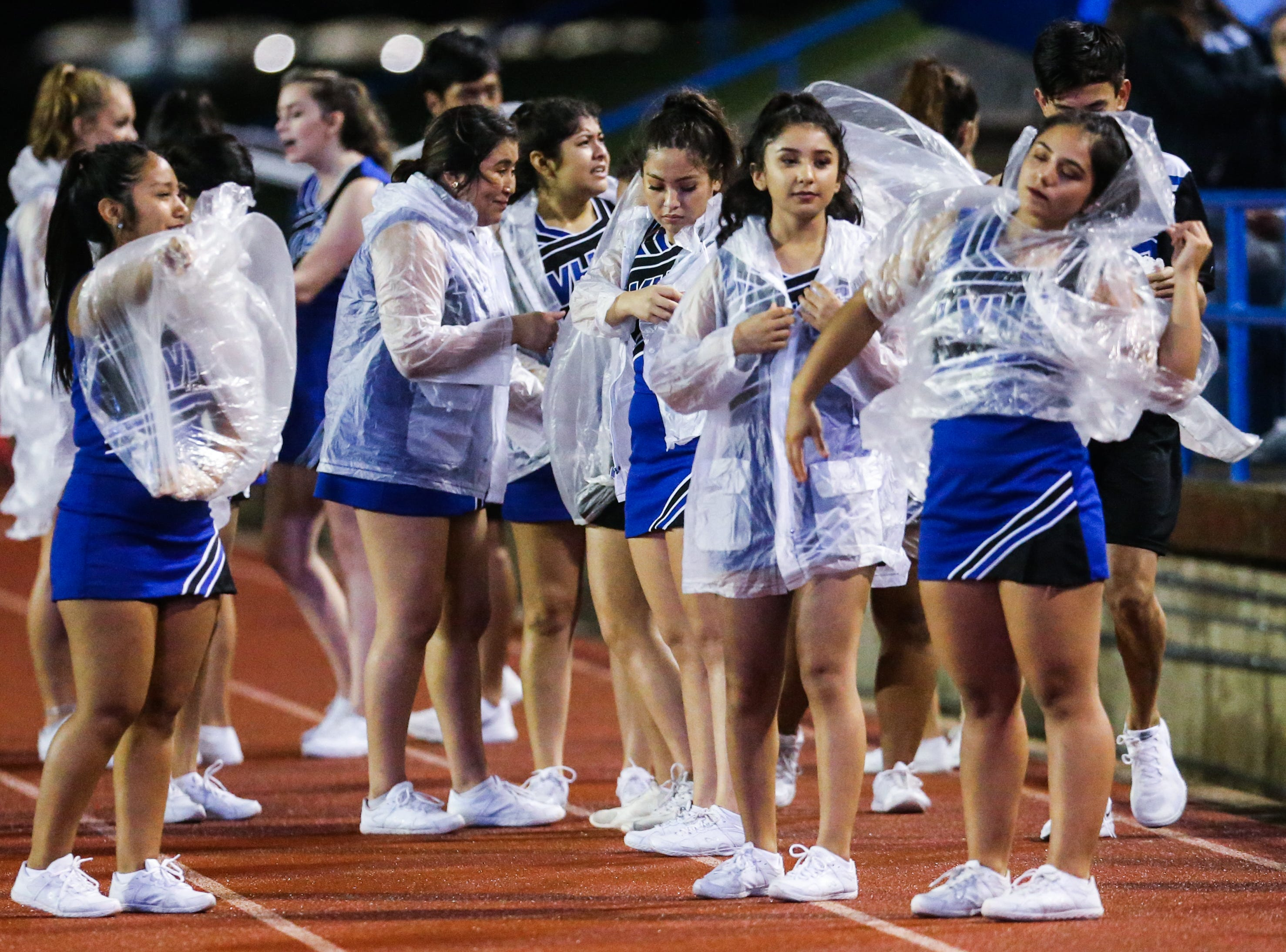 Lake View's cheerleaders put on ponchos during the game against Fabens Friday, Sept. 7, 2018, at San Angelo Stadium.
