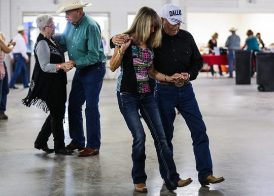 Dancers spin around the dance floor during the 6th annual Cowboy Gathering Saturday, Sept. 8, 2018, at Wells Fargo Pavilion.