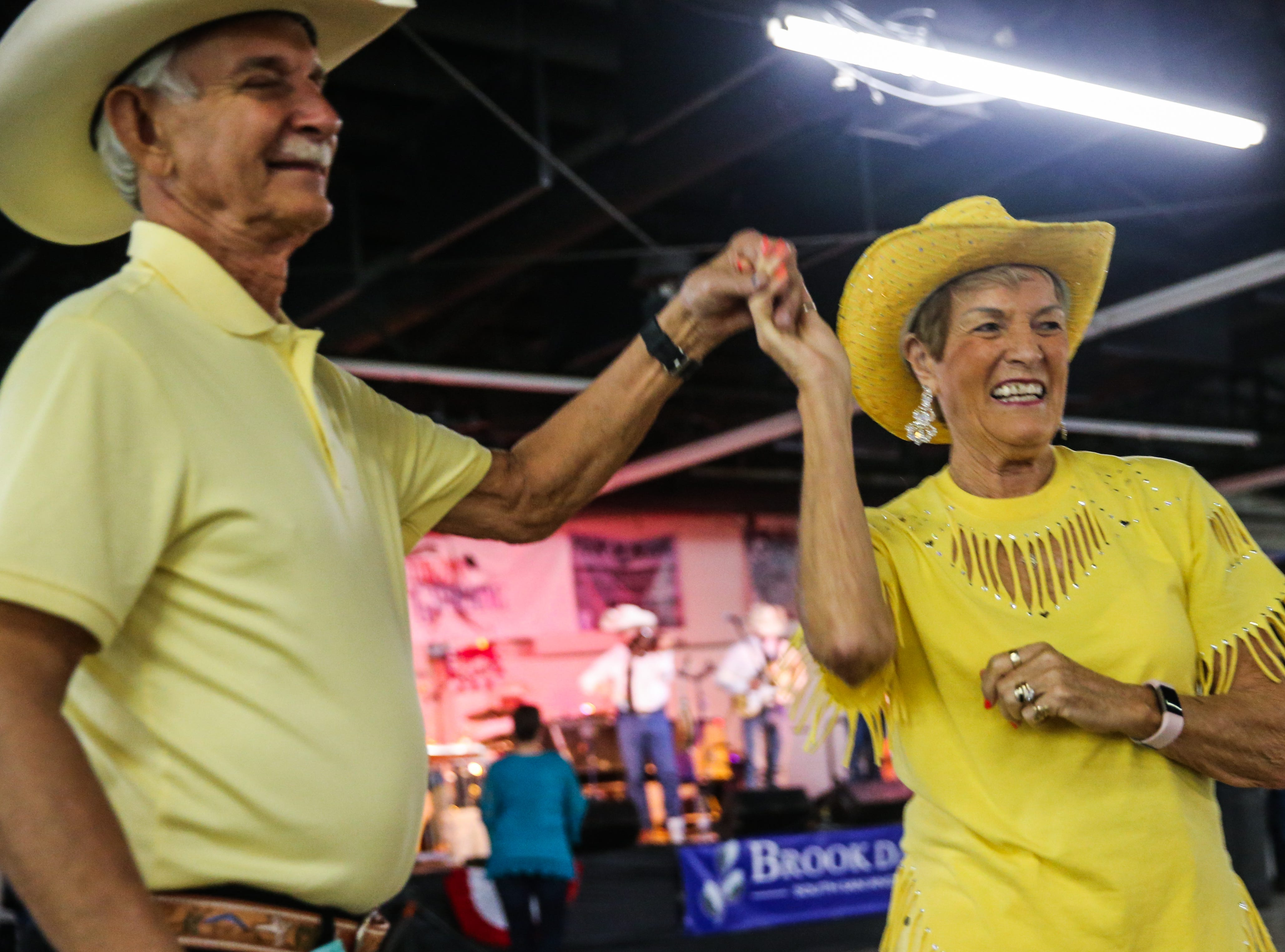 Floyd Harding spins Vera Meese during the 6th annual Cowboy Gathering Saturday, Sept. 8, 2018, at Wells Fargo Pavilion.