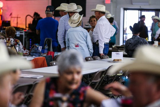 Friends chat amount the tables set up during the 6th annual Cowboy Gathering Saturday, Sept. 8, 2018, at Wells Fargo Pavilion.