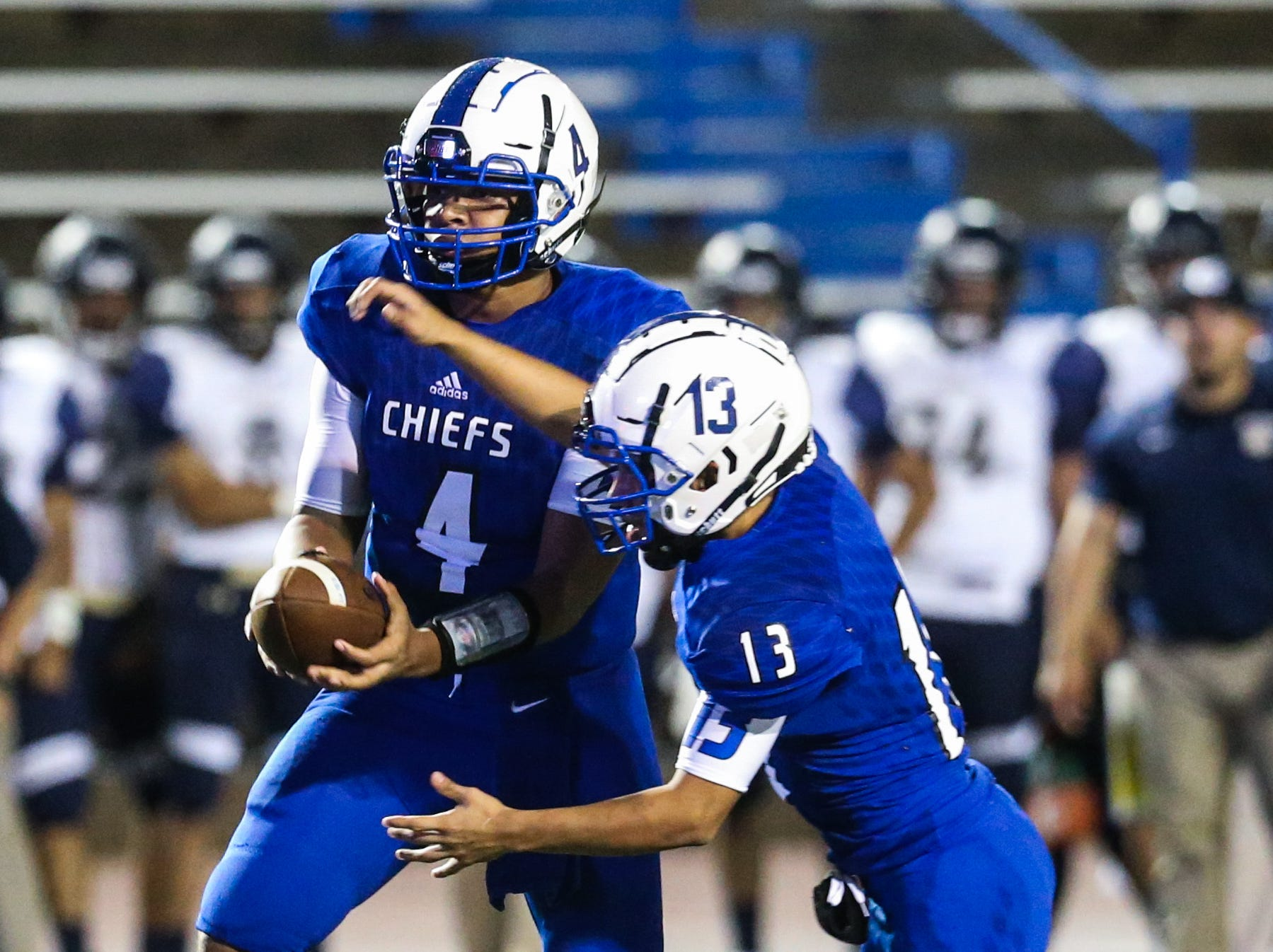 Lake View's Kendall Blue passes the ball to Rudy Martinez during the game against Fabens Friday, Sept. 7, 2018, at San Angelo Stadium.