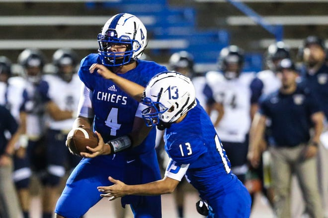 Lake View's Kendall Blue hands the ball to Rudy Martinez during the game against Fabens on Friday, Sept. 7, 2018, at San Angelo Stadium.