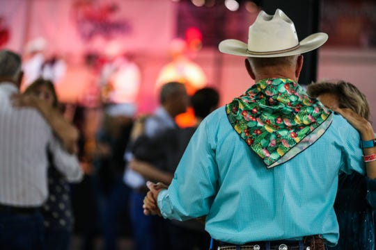 Music lovers dance during a concert in San Angelo.