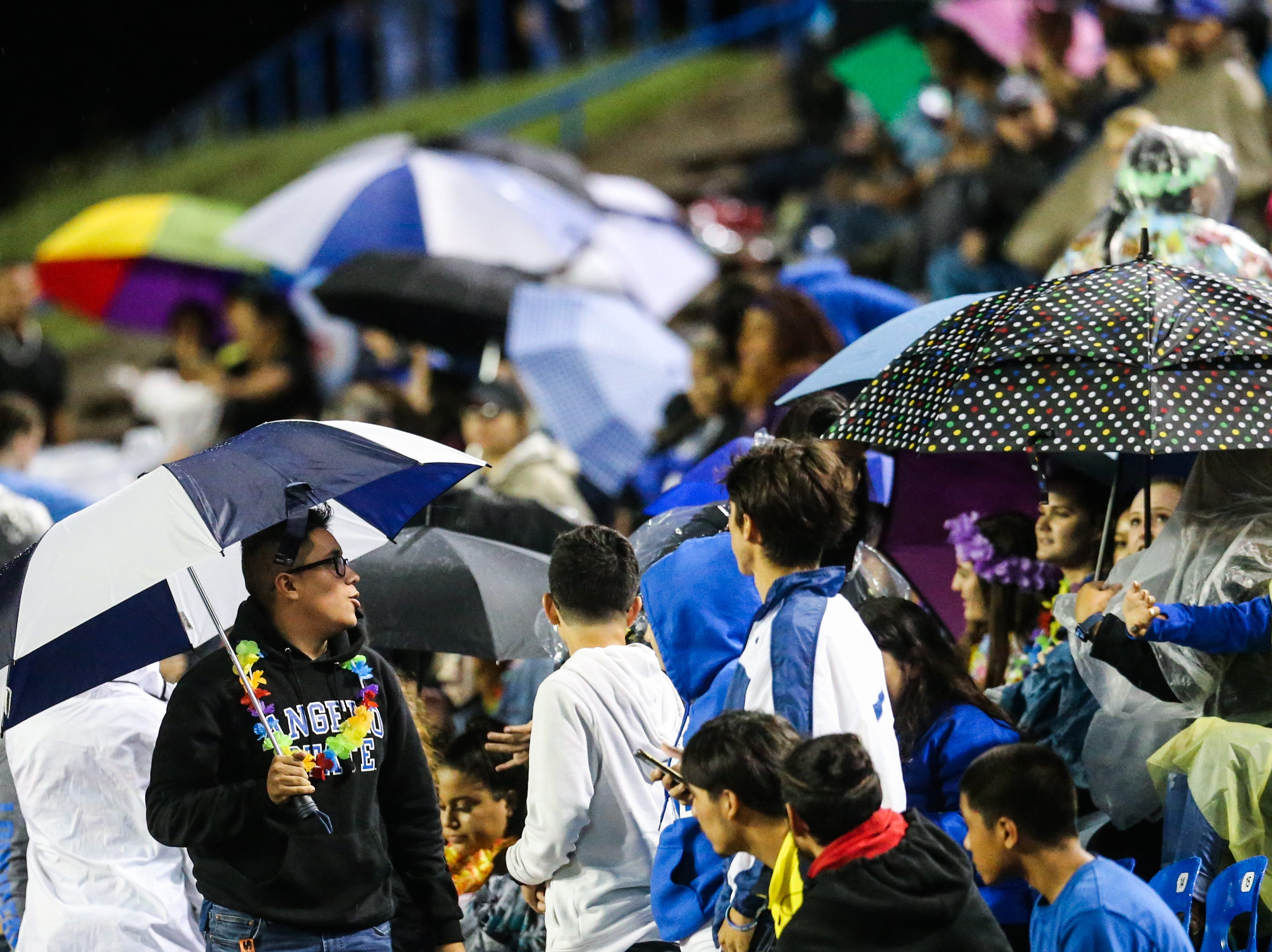 Lake View's fans open up their umbrellas against the rain  during the game against Fabens Friday, Sept. 7, 2018, at San Angelo Stadium.