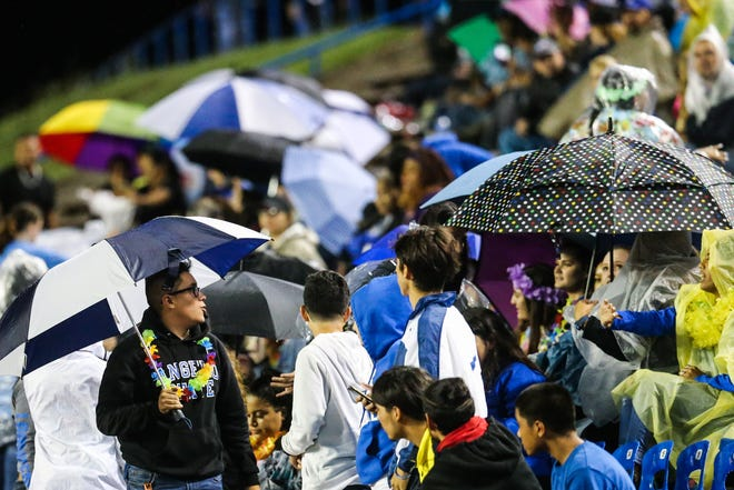 Lake View fans open up their umbrellas against the rain during the game against Fabens on Friday, Sept. 7, 2018, at San Angelo Stadium.