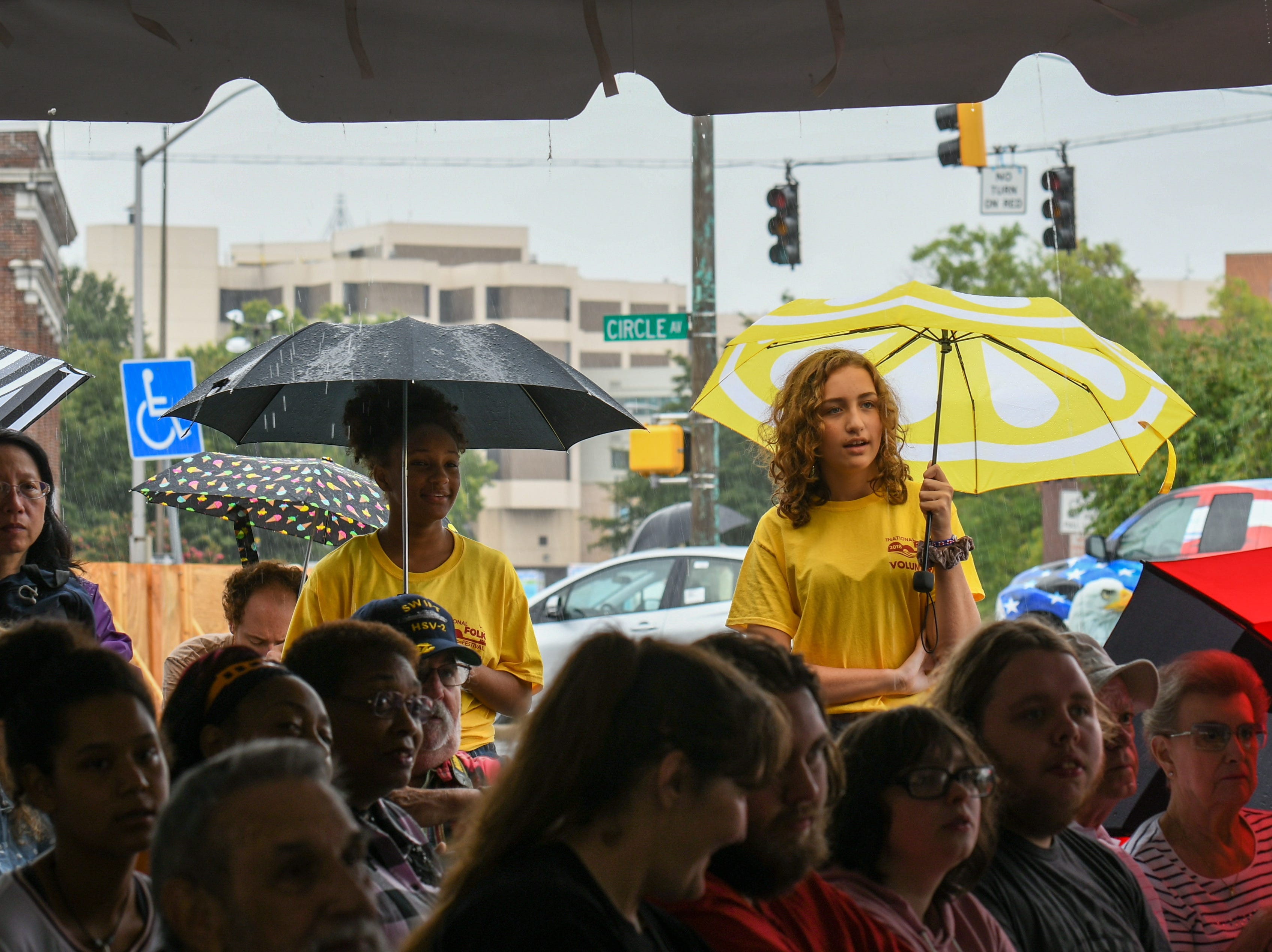Crowds watch from the rain at the full tent at Sounds of Korea performance at the National Folk Festival in Salisbury on Saturday, Sept. 8.