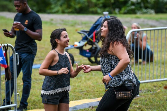Stephanie Martinez (left) and Laura Almodovar dance to the music of Orquesta SCC at the National Folk Festival in Salisbury on Saturday, Sept. 8.