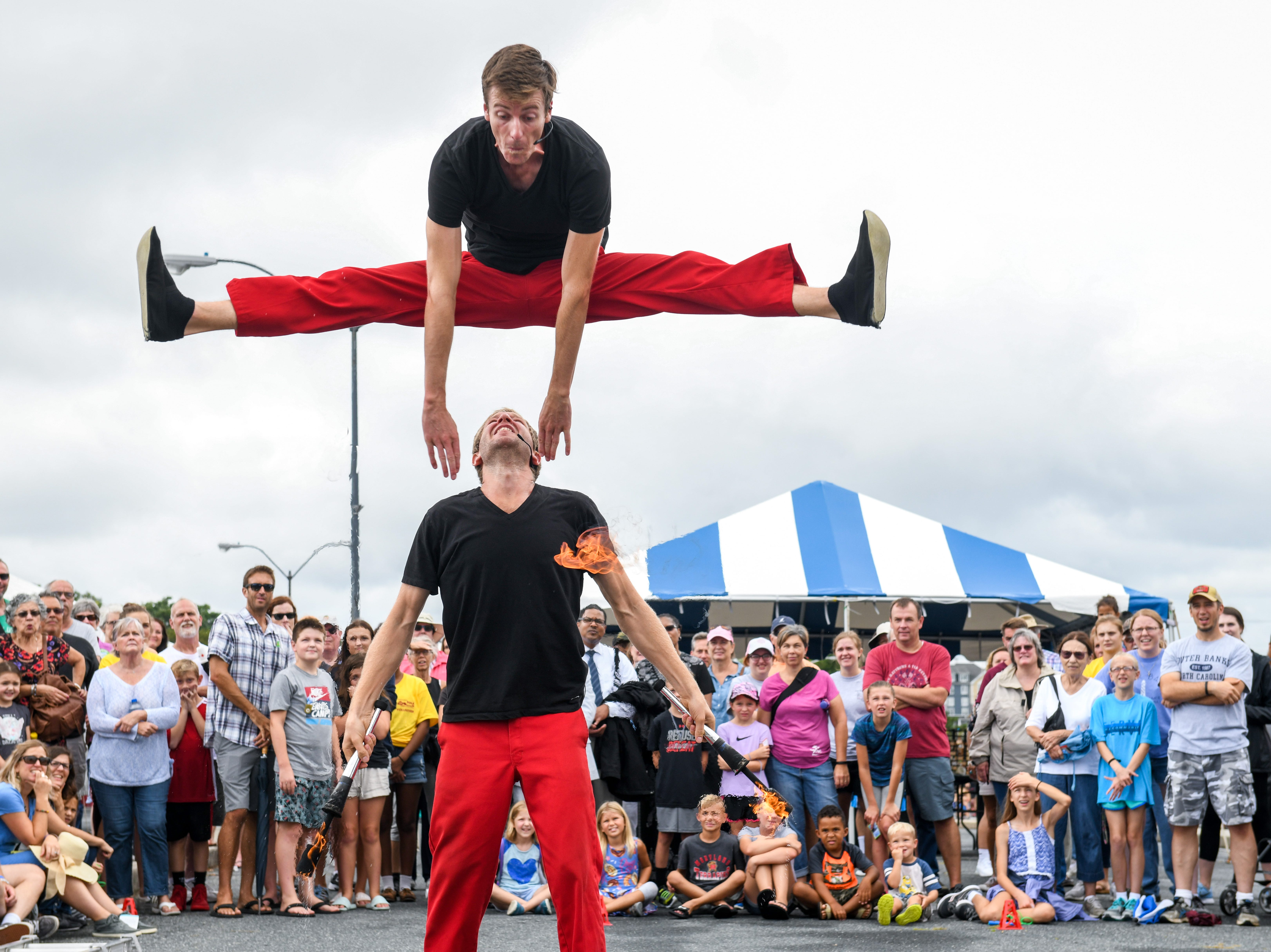 The Red Trouser Show group performs at the National Folk Festival in Salisbury on Saturday, Sept. 8.