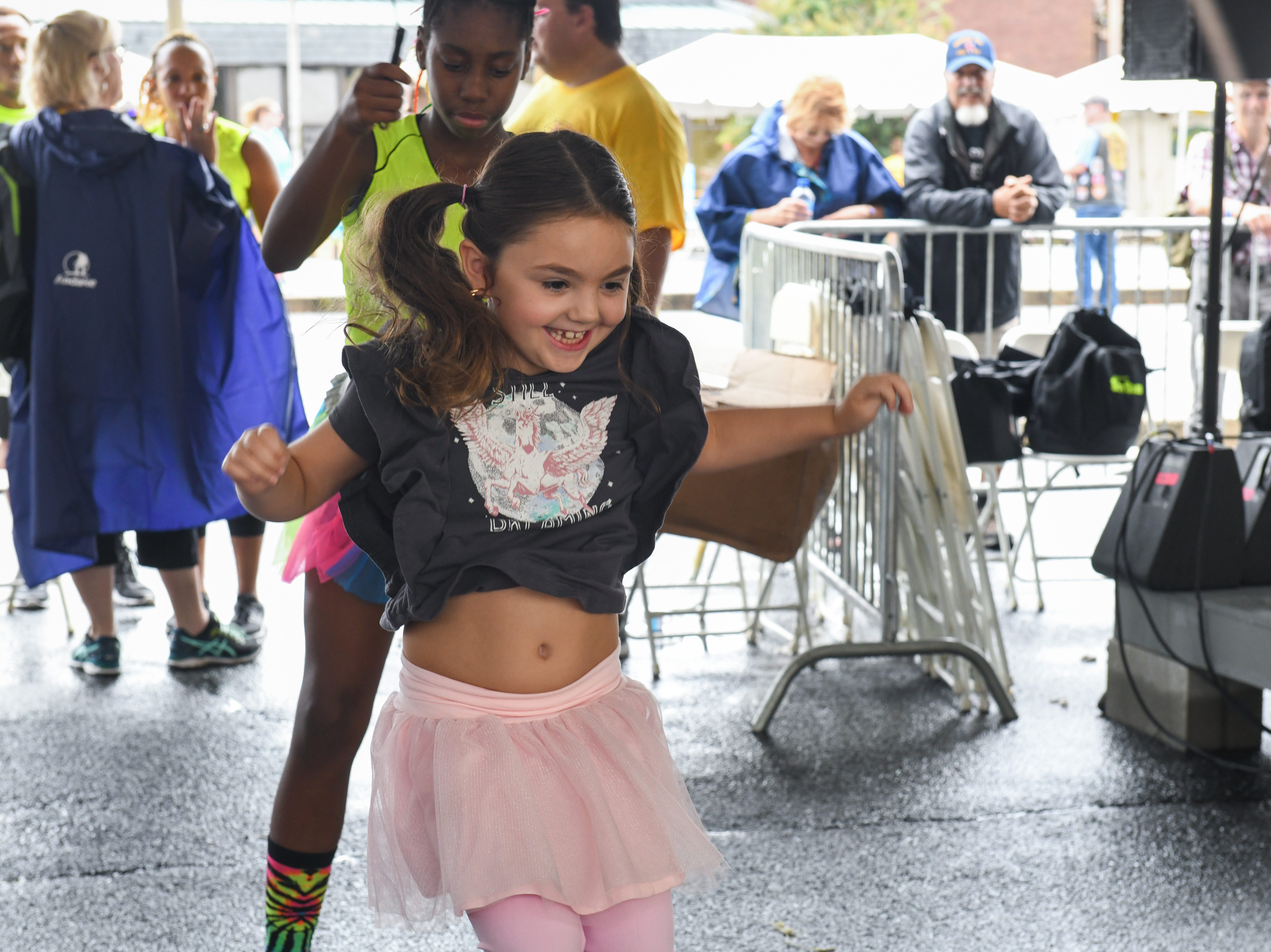7-year-old Hadley Rugel jumps rope with the Greenbelt S.I.T.Y Stars precision jumprope team at the National Folk Festival in Salisbury on Saturday, Sept. 8.