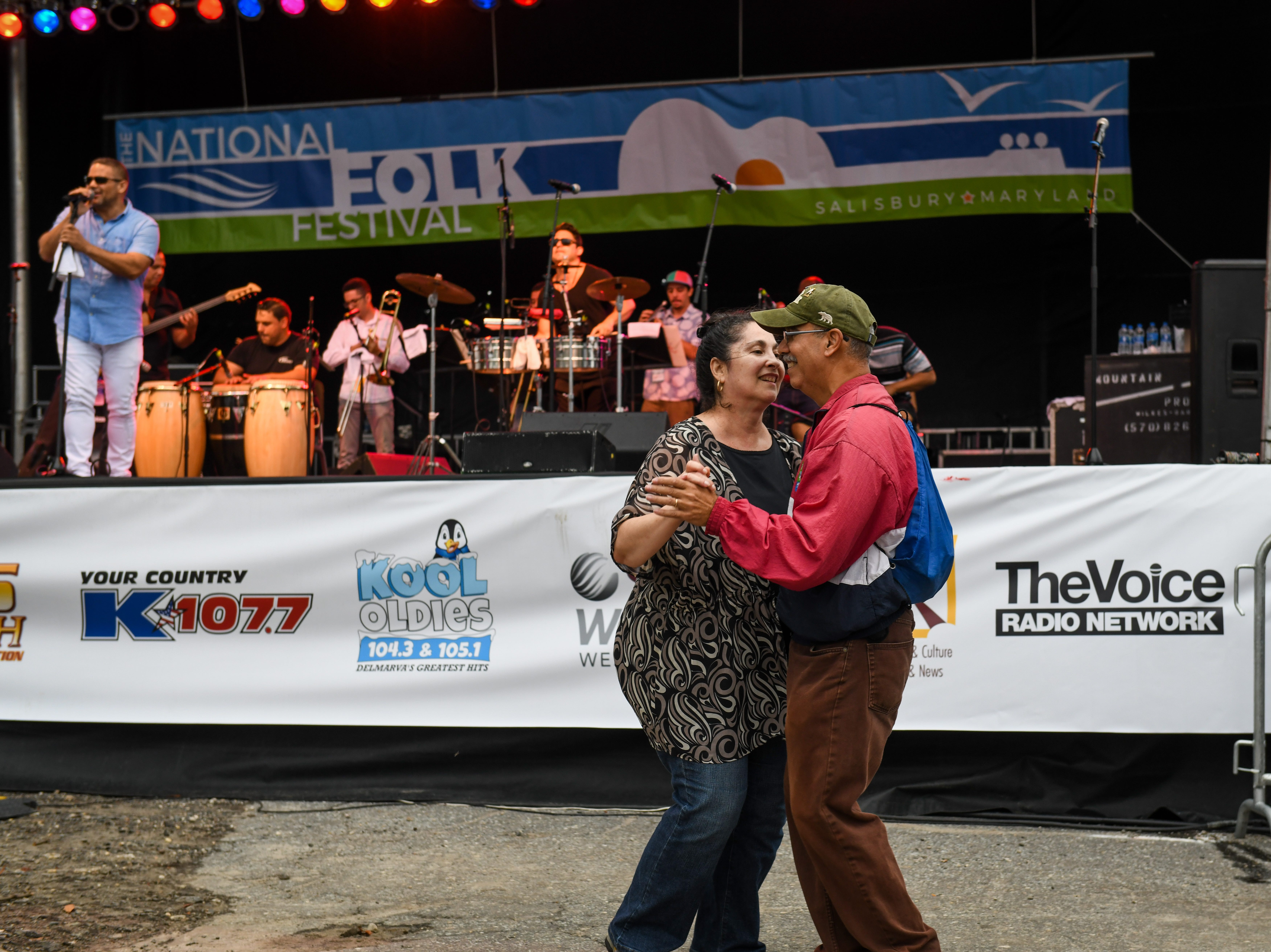 Festival-goers dance to the music of Orquesta SCC at the National Folk Festival in Salisbury on Saturday, Sept. 8.