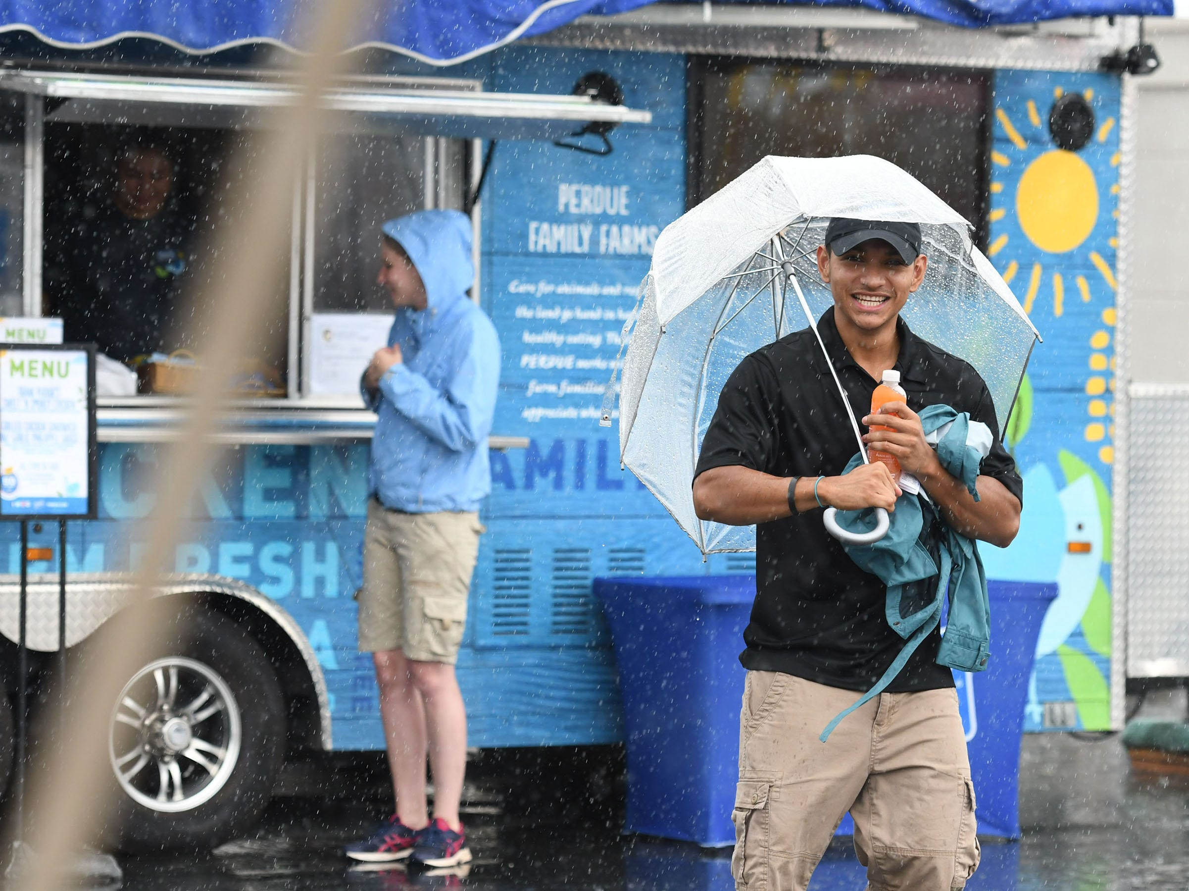 A bit of rain will not stop the fun at the 78th National Folk Festival in Salisbury, Md. on Saturday, Sept. 8, 2018.