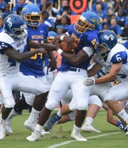 Stephen Decatur's Cameron Kodua runs the ball  during game action Friday at Wicomico High School in Salisbury.