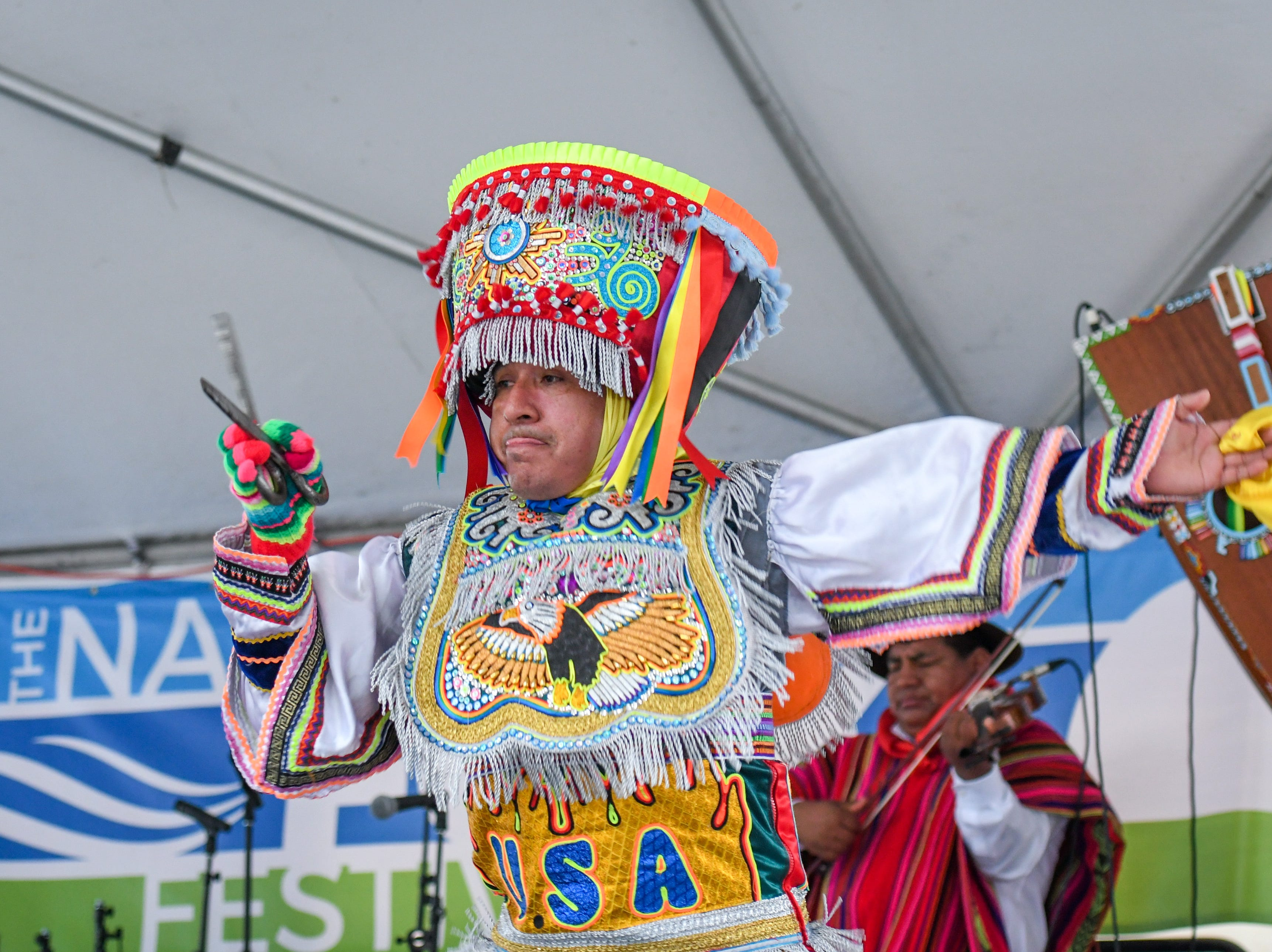 The Chankas of Peru perform an Andean scissors dance at the National Folk Festival in Salisbury on Saturday, Sept. 8.