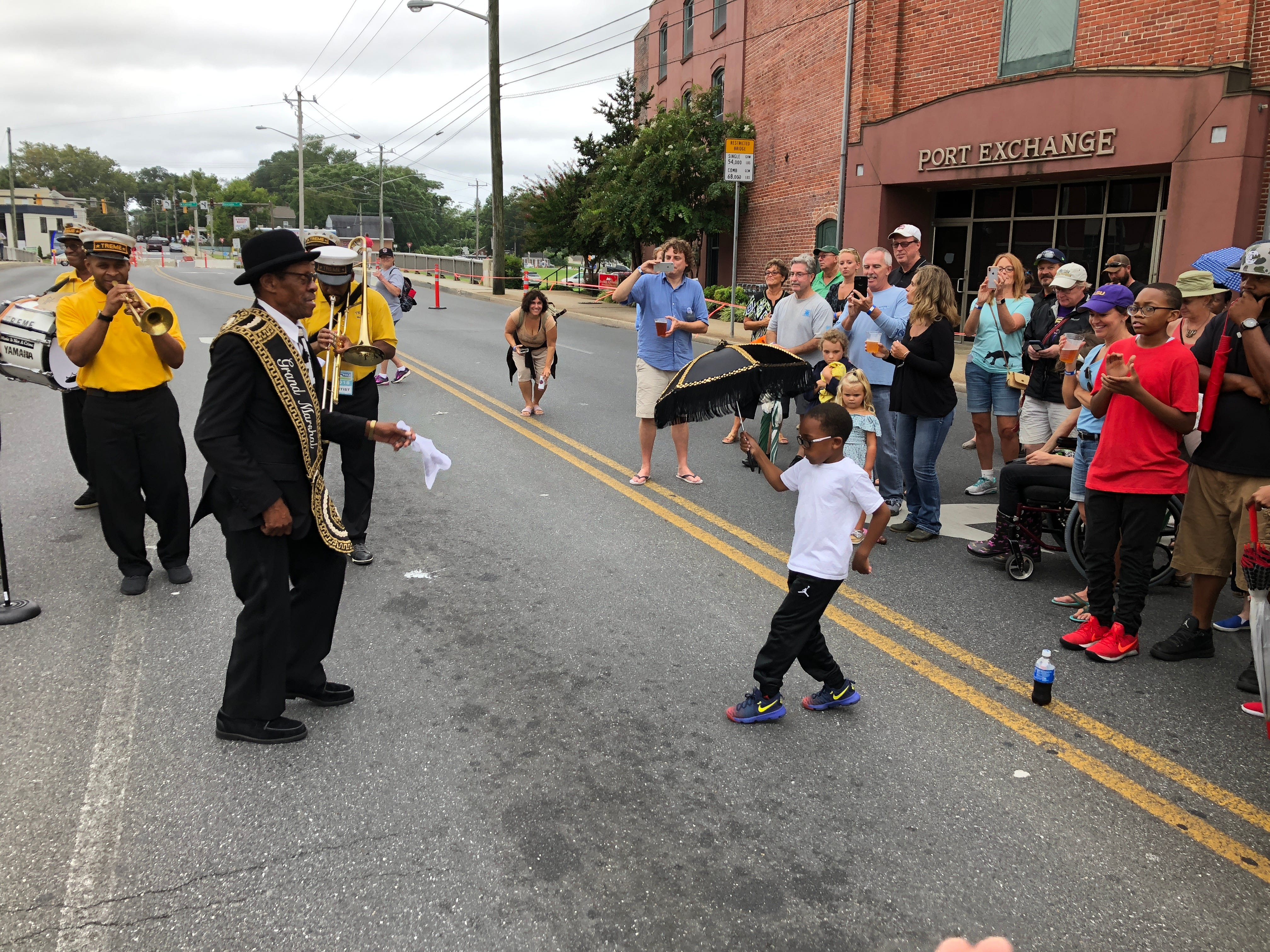 Kristian Fletcher, 6, gets in the dancing spirit with the Treme Brass Band on Saturday at the National Folk Festival. Fletcher will celebrate a birthday next week.