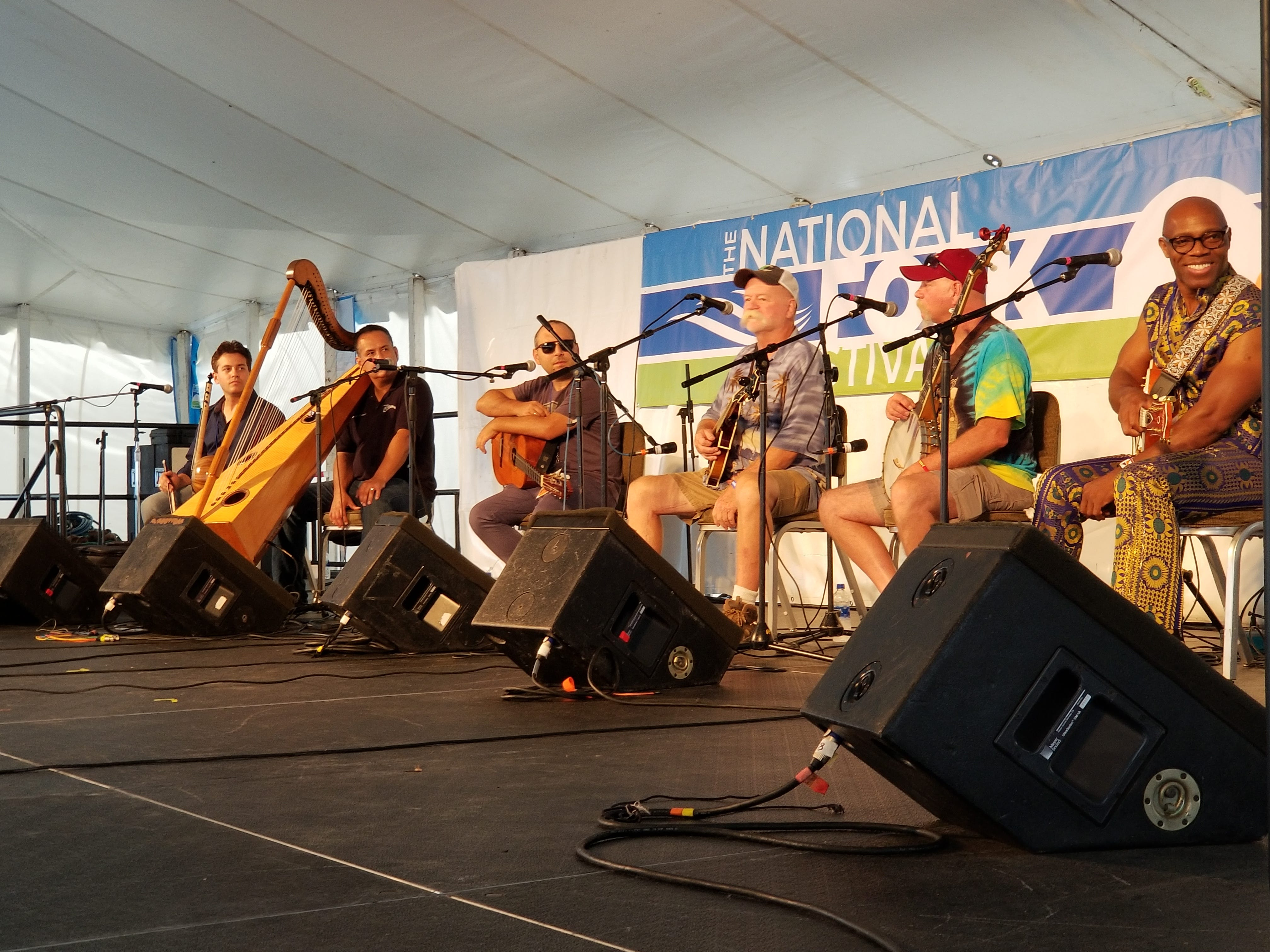 Performers from several groups enjoyed an impromptu jam session at the Richard A. Henson Stage at the National Folk Festival in Salisbury, Maryland on Sept. 8, 2018.