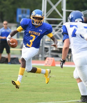 Wi-Hi's quaterback Khalil Evens runs the ball during game action Friday at Wicomico High School in Salisbury.
