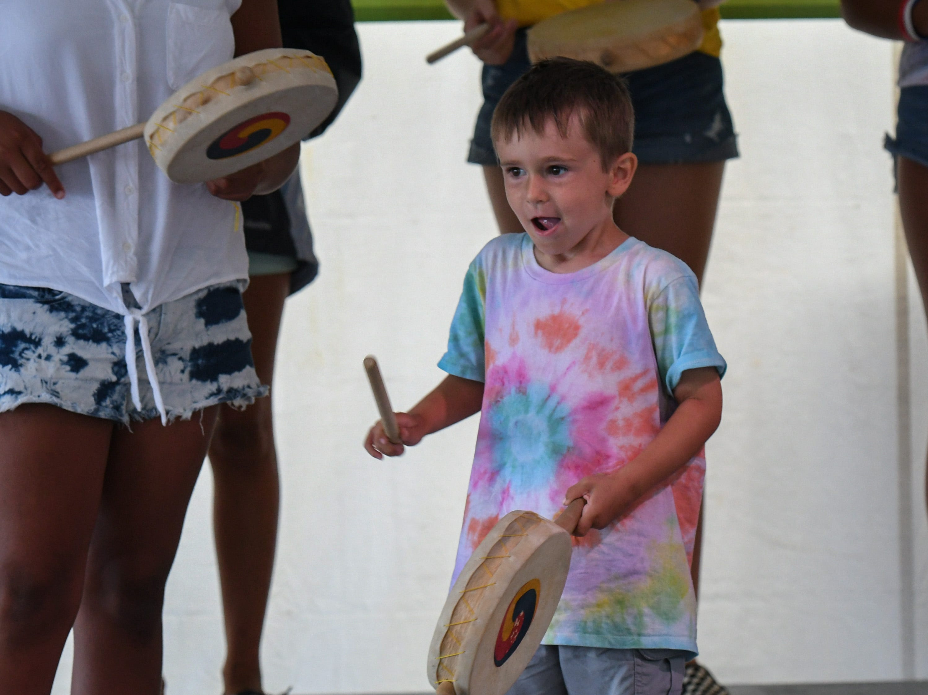 4-year-old Parker Beck learns a dance from the Sounds of Korea group at the National Folk Festival in Salisbury on Saturday, Sept. 8.